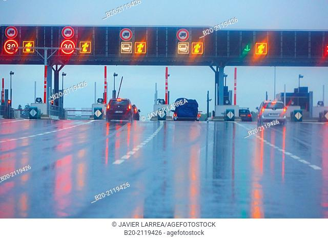 Driving in bad weather on the motorway. Highway toll. Rain. near Bordeaux. Aquitaine. France