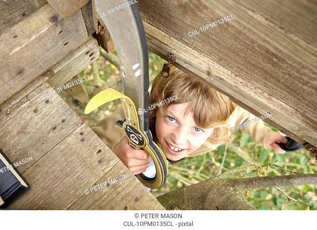 Boy climbing to treehouse