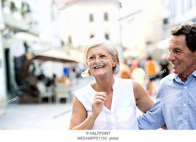 Happy senior couple on city trip