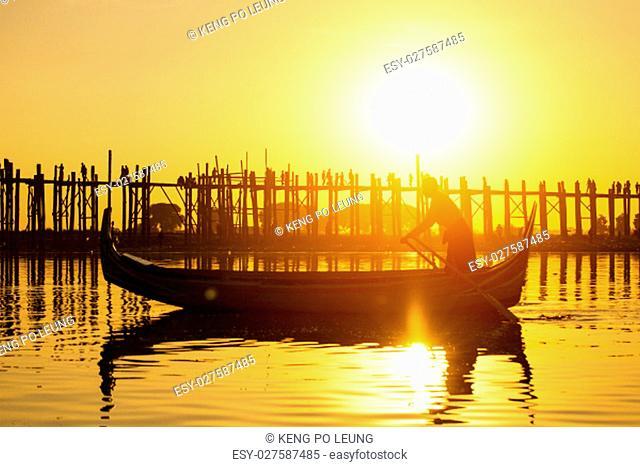 Fishman under U bein bridge at sunset, Myanmar landmark in mandalay