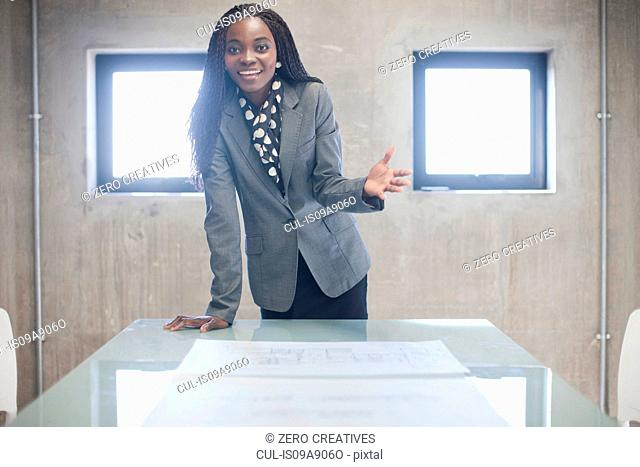 Young woman in boardroom