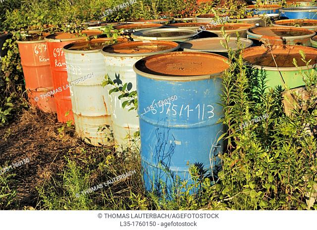 old rusty barrels of fruit syrup