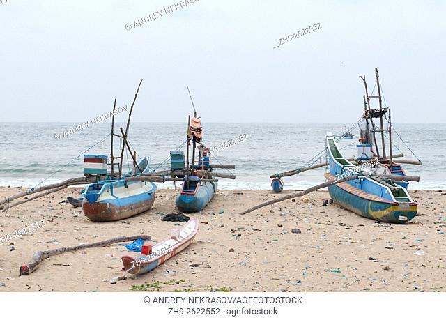 many traditional catamaran Fishing Boats Sri Lanka on beach, Hikkaduwa, Sri Lanka, South Asia