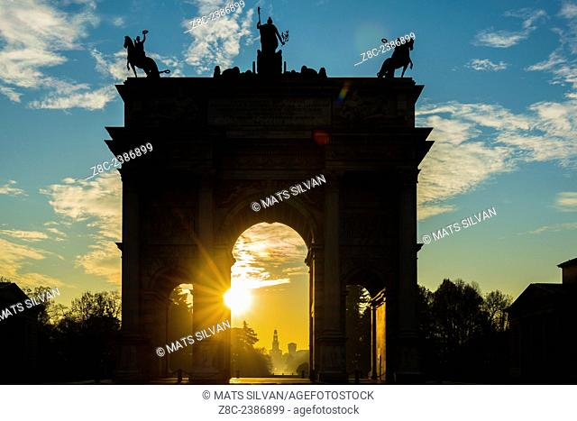 Arco della Pace and Castle Sforza in sunrise and blue sky with clouds in Milan, Italy