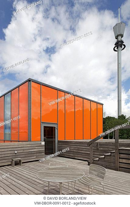 Rooftop with orange lift housing and timber decking. Museum Of World Culture, Gothenburg, Sweden. Architect: Brisac Gonzalez Architects, 2004