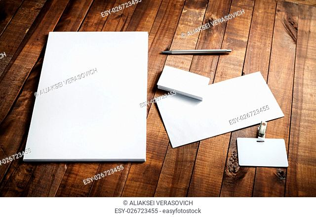 Blank stationery and corporate identity template on vintage wooden table background. Letterhead, business cards, envelope, badge and pen