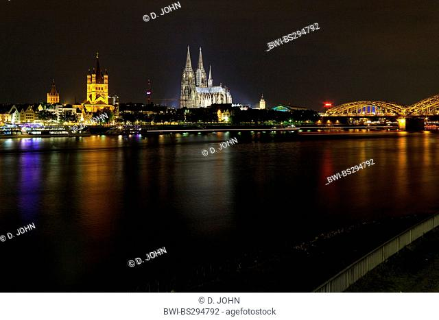 Rhine riverside in Cologne at night, with old city, chuirch Gross St. Martin and Cologne cathedral, Germany, North Rhine-Westphalia, Cologne