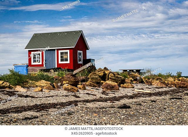 An old wooden lobsterman's shack on a remote Maine island