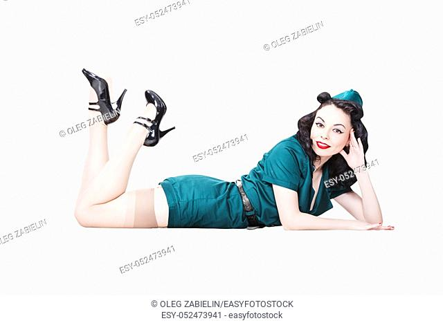 Portrait of Beautiful Brunette with black hair. Pin up Female Dressed in military clothing Uniform and Garrison cap feet up. Army Pin-up Girl Concept