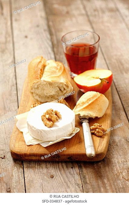 Camembert with nuts, baguette, apple and rose wine