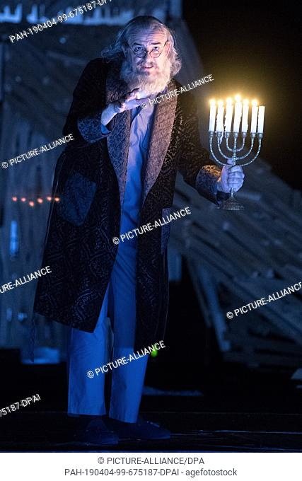 """03 April 2019, Saxony, Dresden: The actor Holger Hübner is on stage during a photo rehearsal for the play """"""""Eine Straße in Moskau"""""""" at the Staatsschauspiel..."""