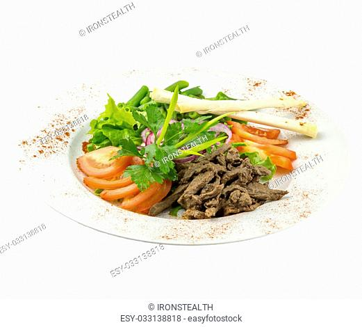 Salad with fresh vegetables, meat and rice bread on an isolated background
