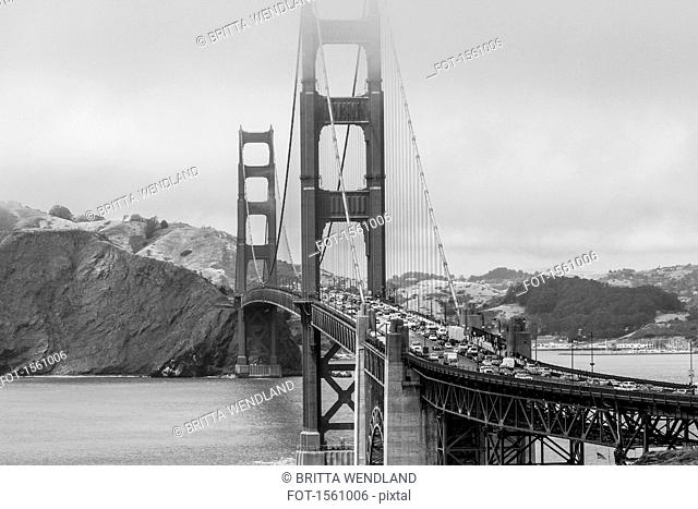 View of Golden Gate Bridge over bay of water against mountain, San Francisco, California, USA