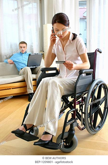 Woman in wheelchair with mobile