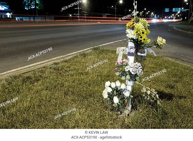 Road side cross at urban intersection memorial for traffic death