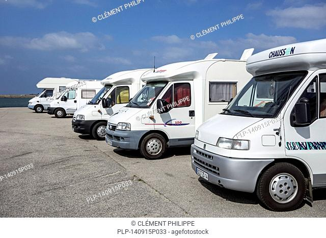 Row of motorhomes parked along the coast with view over the sea