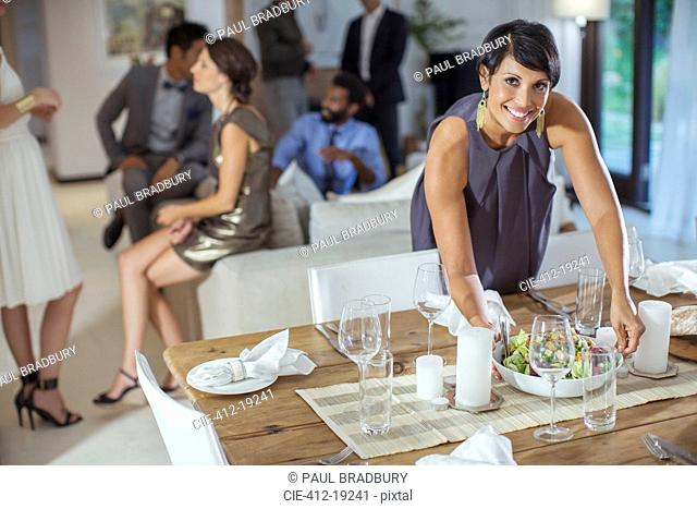 Woman serving food at dinner party