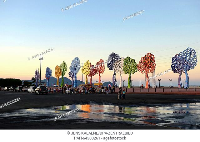 Colourful tree-shaped sculptures seen on the El Malecon promenade at sunset at the Puerto Salvador Allende port in Managua, Nicaragua, 27 November 2015