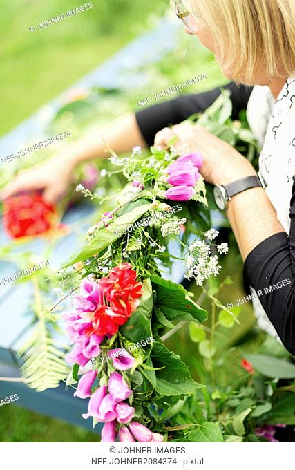 Mid adult woman holding flowers