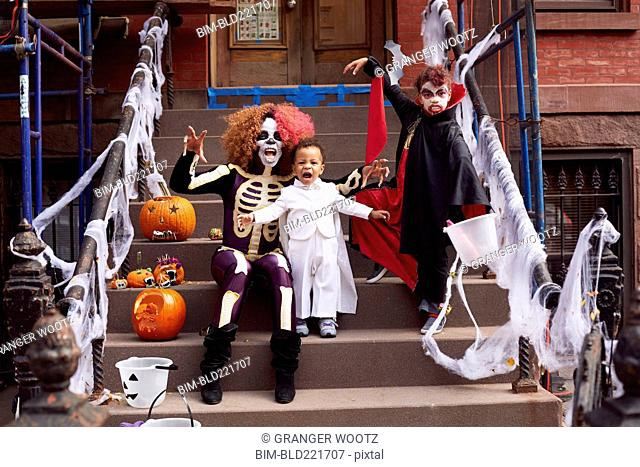 Mother and children wearing Halloween costumes