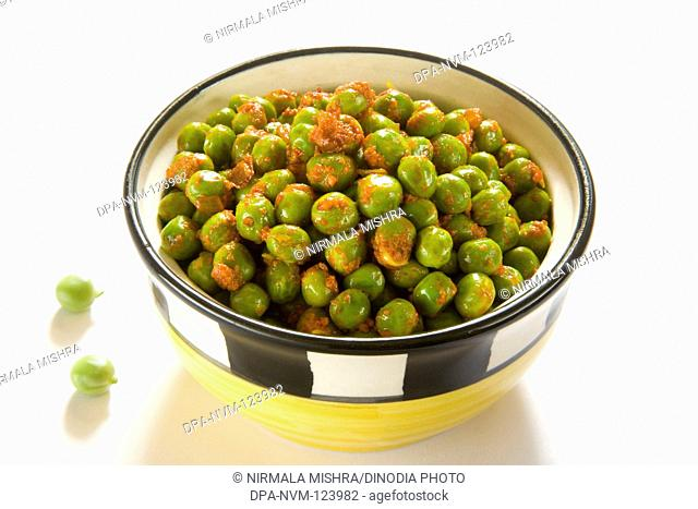 Vegetable green peas mutter Indian cuisine spicy breakfast or snack served in bowls , India