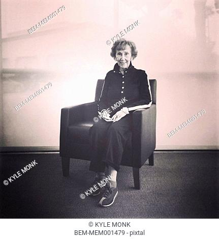 Senior Caucasian woman smiling in armchair