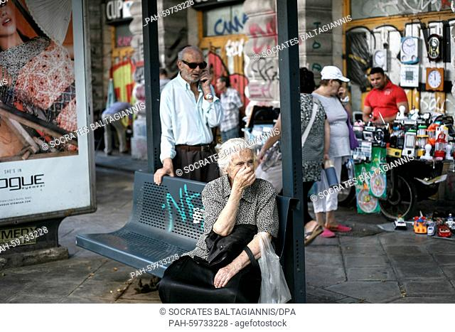 An elderly woman wait for the bus near Omonia square in Athens, Greece on the 2nd of July 2015. Greece's government has made new concessions in talks with its...