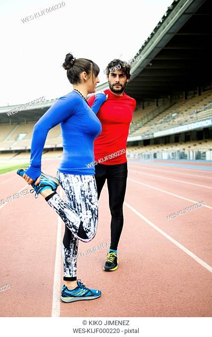 Athletes training for race in stadium