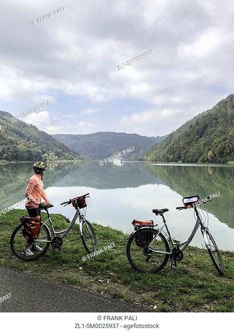 Bikers along the Danube watching cruiseship