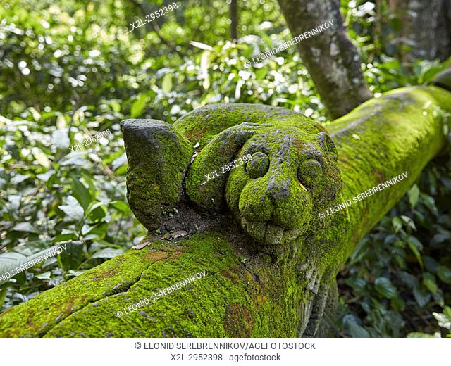 Mossy stone statue in the Sacred Monkey Forest Sanctuary. Ubud, Bali, Indonesia