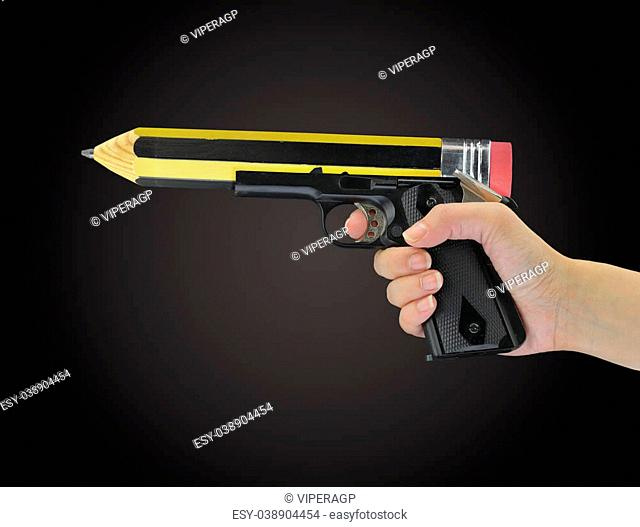 Hand holding gun with pencil point isolated on black