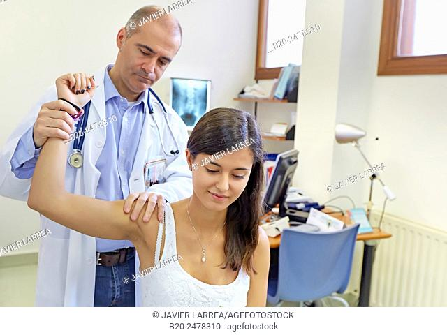 Doctor examining patient's arm and shoulder, Ambulatory Lezo, Gipuzkoa, Basque Country, Spain