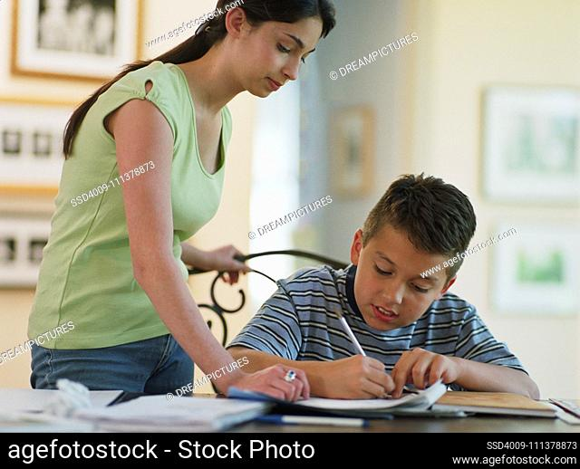 Sister helping brother with homework