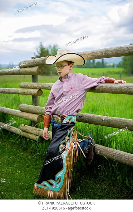 Young cowboy with his chaps and hat and spurs.Telkwa, British Columbia