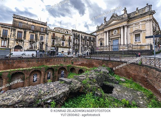 Ruins of Roman Amphitheatre and San Biagio church (R) at Piazza Stesicoro (Stesicoro Square) in Catania city on the east side of Sicily Island, Italy