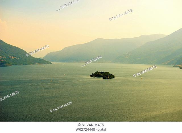 Brissago islands on alpine lake Maggiore with mountain in Ticino, Switzerland