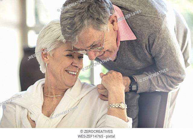 Happy affectionate senior couple together at home