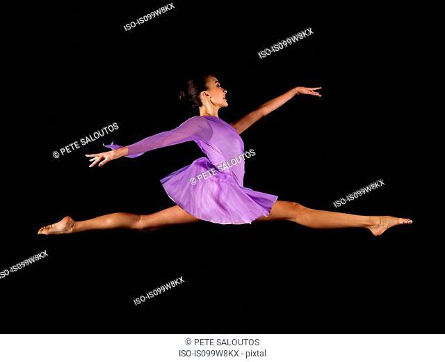 Ballerina doing the splits in mid air