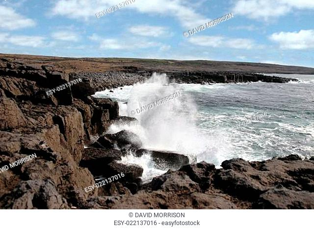 wave crashing on coastline cliffs