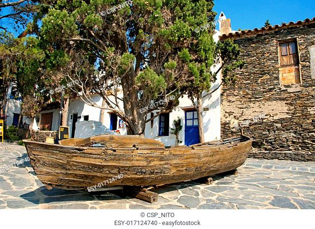 Old boat with a cypress in Portlligat, Cadaques, Spain