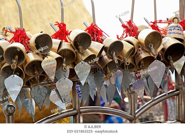 Offering, bells, at the Kyaiktiyo Pagoda, Golden Rock, Kyaiktiyo, Myanmar or Burma. Kyaiktiyo Pagoda also known as Golden Rock is a well known Buddhist...