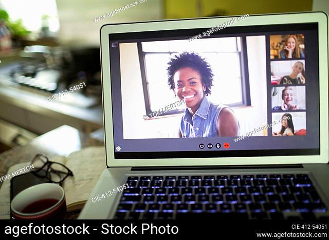 Happy women friends video conferencing on laptop screen