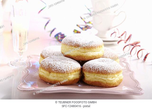 Doughnuts for carnival with streamers and a glass of champagne