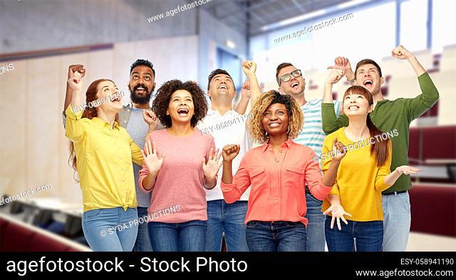 group of smiling international university students