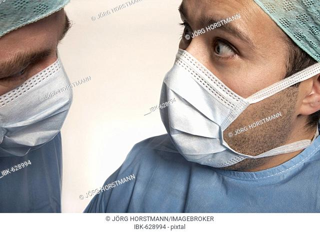 Two surgeons with looks of horror on their faces