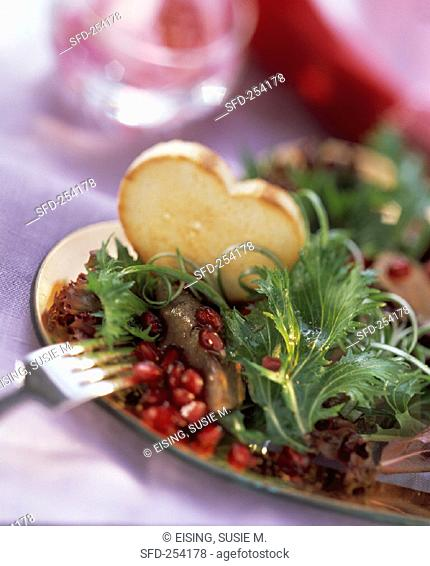 Pomegranate and Baby Greens with Duck Liver