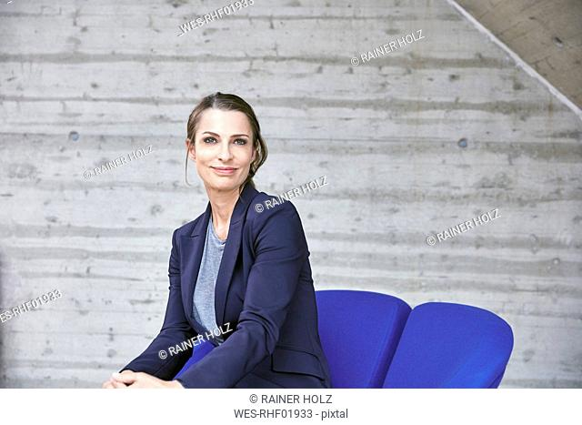 Smiling businesswoman sitting on chair