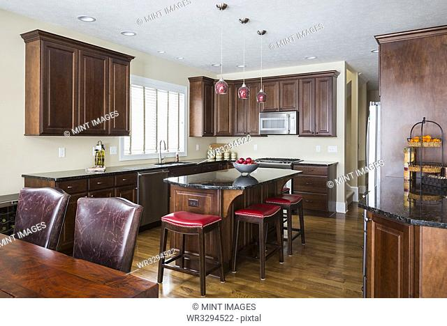 Kitchen island, table and cabinets in modern kitchen