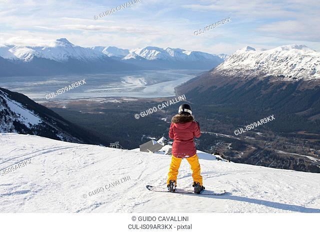 Young woman on snowboard, Girdwood, Anchorage, Alaska