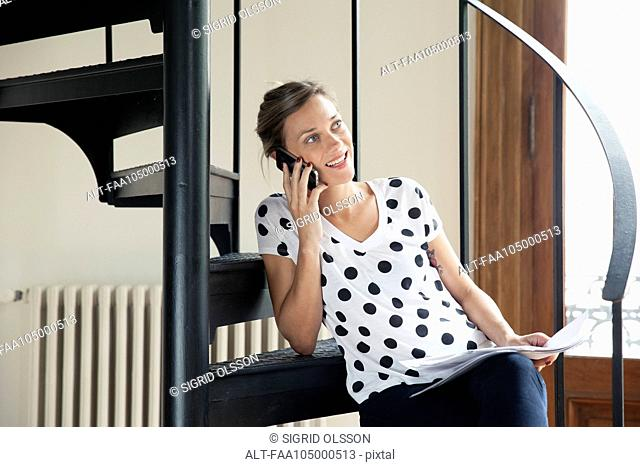 Woman taking phone call on cell phone